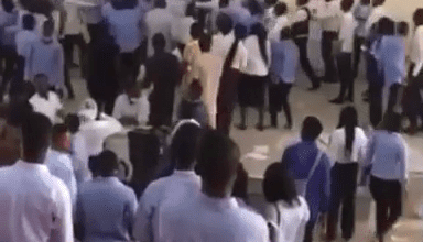 Photo of Uniabuja students allegedly beat lecturer for collecting answer scripts, 45mins into a 3-hour exam (video)